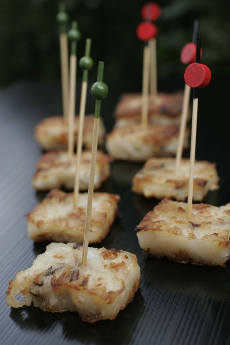 Daikon Mochi - White radish, dried shrimp cake, served with Japanese mustard or chili and soy sauce
