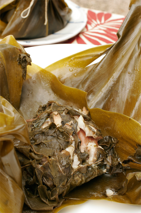 Chicken Lau Lau - Marinated chicken with ginger, sake and soy sauce, wrapped in fresh taro and ti leaves