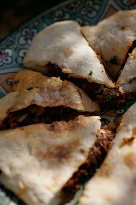 Medfouna - Moroccan celebration food. Aromatic lamb baked in a hand made thin bread