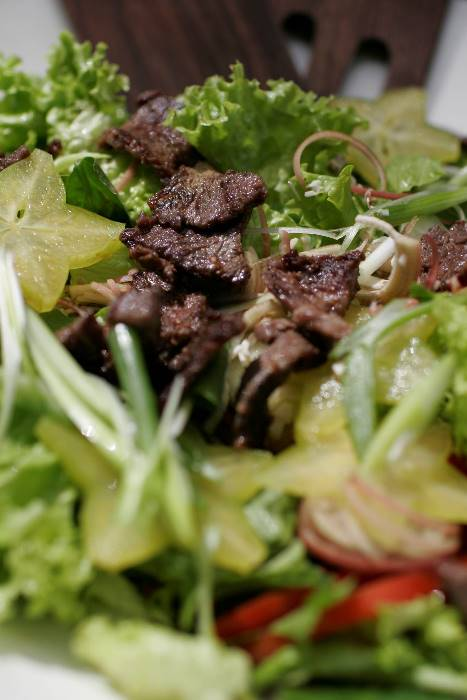 Thai Beef and Fruit Salad - Seasonal fresh island fruits and greens with grilled beef
